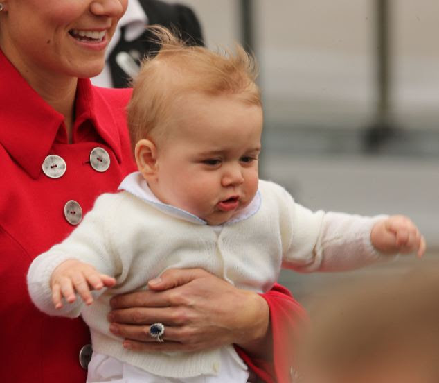 Flying high: The Duke and Duchess of Cambridge with Prince George arrive at Wellington Airport in New Zealand at the start their Royal tour of the country