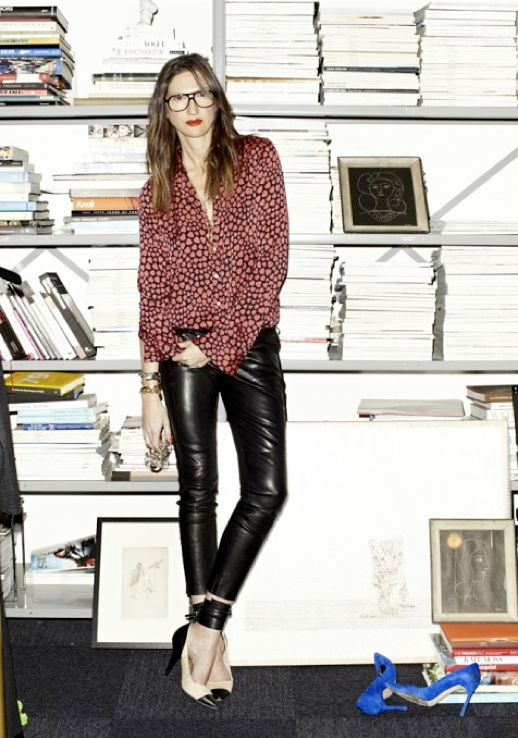 LE FASHION JENNA LYONS OFFICE JCREW INTERIOR DESIGN OFFICE INSPIRATION MAGAZINE CUT OUT COLLAGE WALL DECOR HEART PRINT BUTTON UP SHIRT LEATHER MOTO PANTS ISABEL MARANT TWO TONE CAP TOE ANKLE WRAP BLACK CREAM HEELS PUMPS TALL BOOKSHELVES STACKED ART BOOTS MAGAZINES BLACK AVIATOR FRAME EYEGLASSES GLASSES RED LIPSTICK 1 photo LEFASHIONJENNALYONSOFFICE1.png