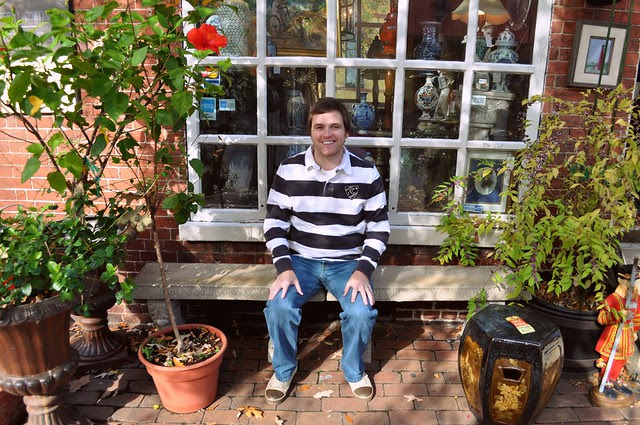 Brandon in Front of an Antique Store