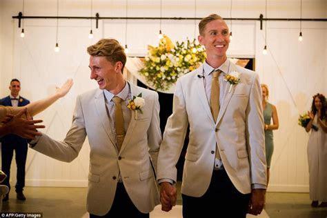 Australian same sex couples marry in midnight ceremonies