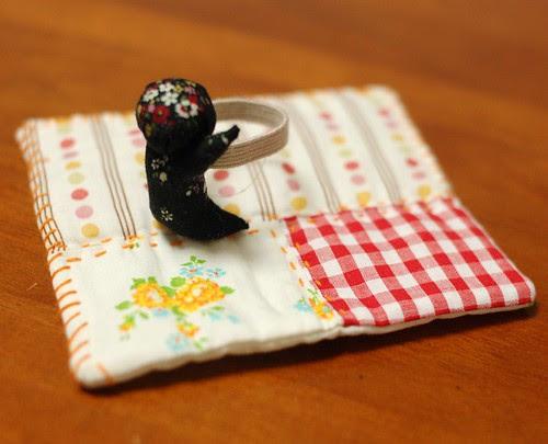 Sarubobo holds coaster