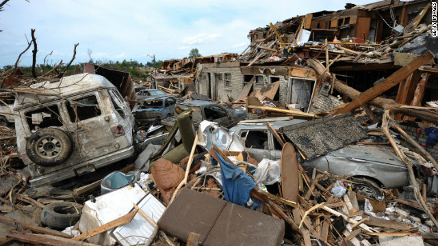 <br/>Damaged buildings and cars litter Tuscaloosa, Alabama, following a deadly tornado in 2011.