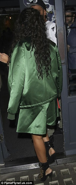 Style star: Leigh-Anne was stylish in a satin green jacket, matching skirt and dazzling heels