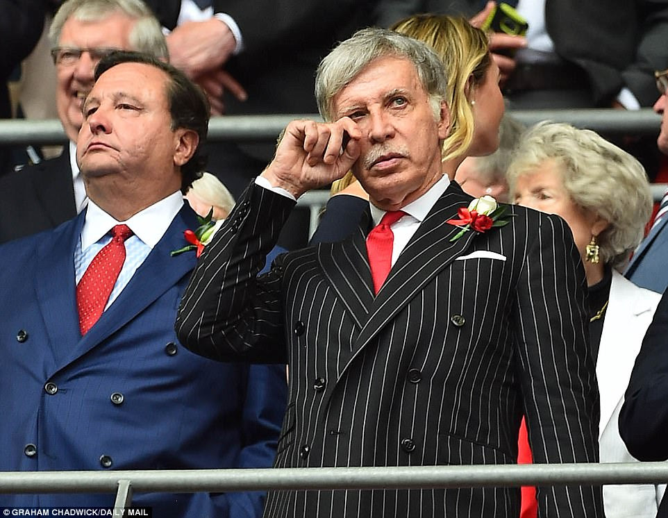 Arsenal's 69-year-old American owner Stan Kroenke wears a pinstripe suit to watch his team in the London derby