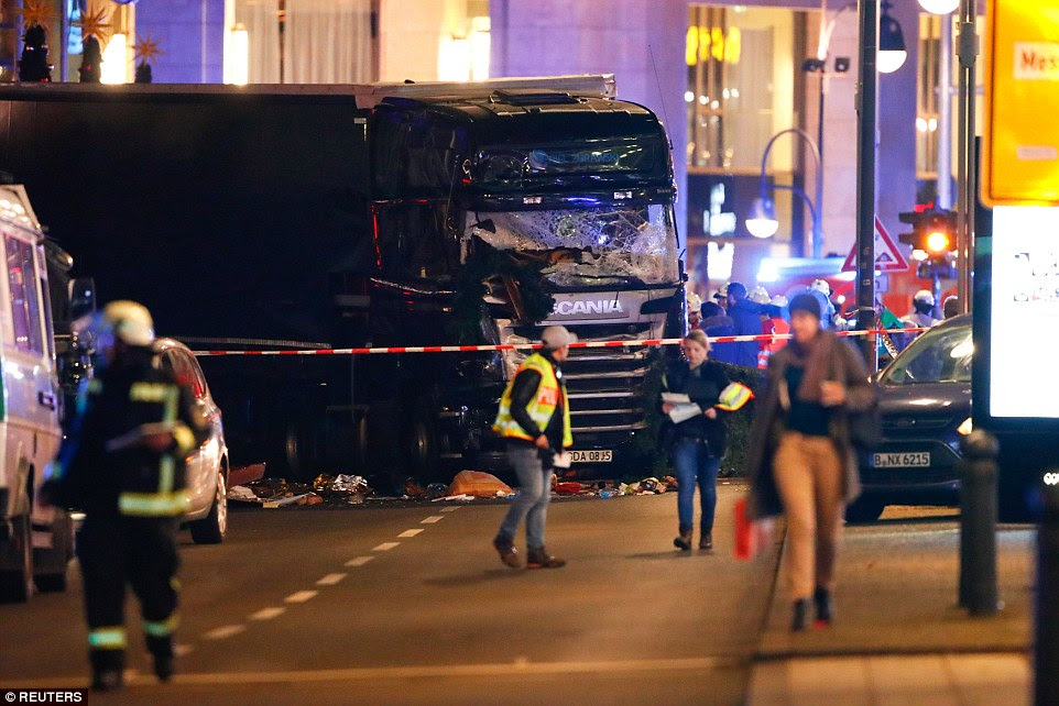 At least nine people have been killed and more than 50 injured after a lorry ploughed through a crowd of shoppers at a busy Christmas market in Berlin