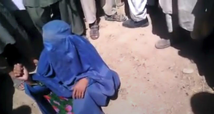 A woman was accused of adultery and publicly executed by the Taliban in Jawzjan, Afghanistan