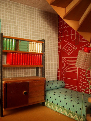 Vintage 1957 Lundby dolls' house reading nook under the stairs.