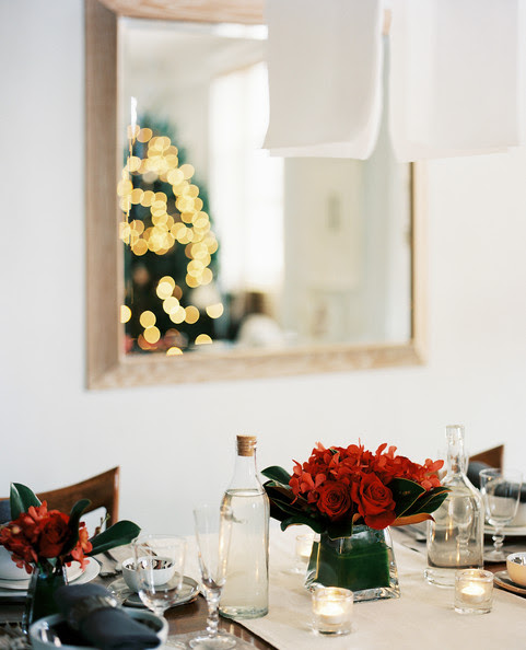 Minimalist Holiday Decor - Vases of red flowers on an elegantly set holiday table
