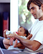 Dad feeding baby a bottle