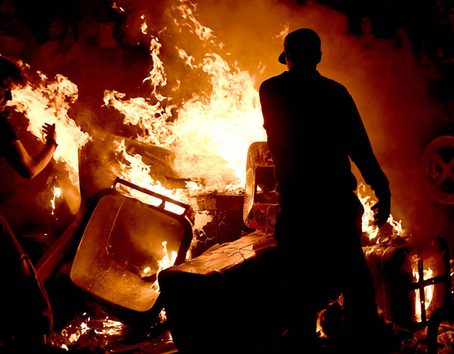 Protesters burn waste in 'Schanzenviertel' quarter close to 'Rote Flora' building ahead of the G20 summit in Hamburg
