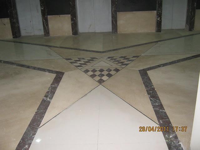 Flooring in elevator lobby of  Sangria Towers at Megapolis Hinjewadi Phase 3, Pune
