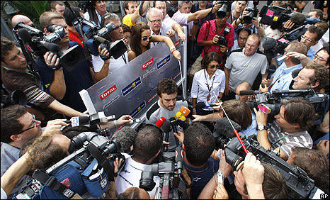 Fernando Alonso is besieged by the media at the Japanese Grand Prix, following the announcement that he will drive for Ferrari in 2010