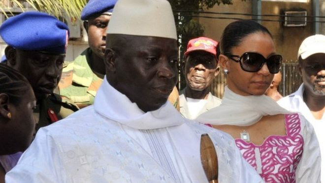 Gambian incumbent Yahya Jammeh (L) accompanied by his wife Zeineb Souma Jammeh (R) gets ready to vote on November 24 2011 at a polling station in the capital Banjul