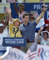 Republican vice-presidential candidate Rep. Paul Ryan, R-Wis., center right, and his mother, Betty Ryan Douglas, wave to supporters at a campaign rally in The Villages, Fla., Saturday, Aug. 18, 2012. (AP Photo/Phelan M. Ebenhack)