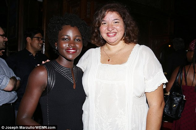 Showing her support: The Mexican-born beauty wore her locks in her curly twists style and was seen posing alongside director Liesl Tammy