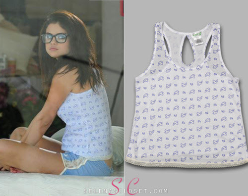 We caught of glimpse of whats to come for Dream Out Loud's Spring 2013 line a few months ago and its finally available! Check out Selena Gomez in this Dream Out Loud Dove Lace Trim Tank Top. You can find it on kmart.com for $7. Buy it HERE She's also wearing Dream Out Loud shorts