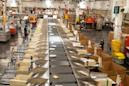 Postal workers are sounding the alarm as mail sorting machines are removed from processing facilities