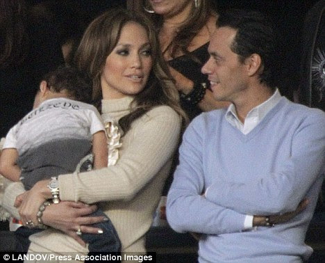 Happier times: Jennifer Lopez and Marc Anthony with one of their children