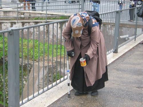 Beggar woman at the Forum