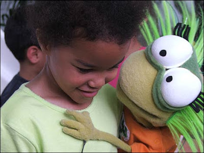 Jelly from UK TV's Cbbebies giving a girl a hug. Jelly and her firend, Detective Dan, will be at Osmaston Park on Sunday. Photo courtesy of bbc.co.uk/birmingham