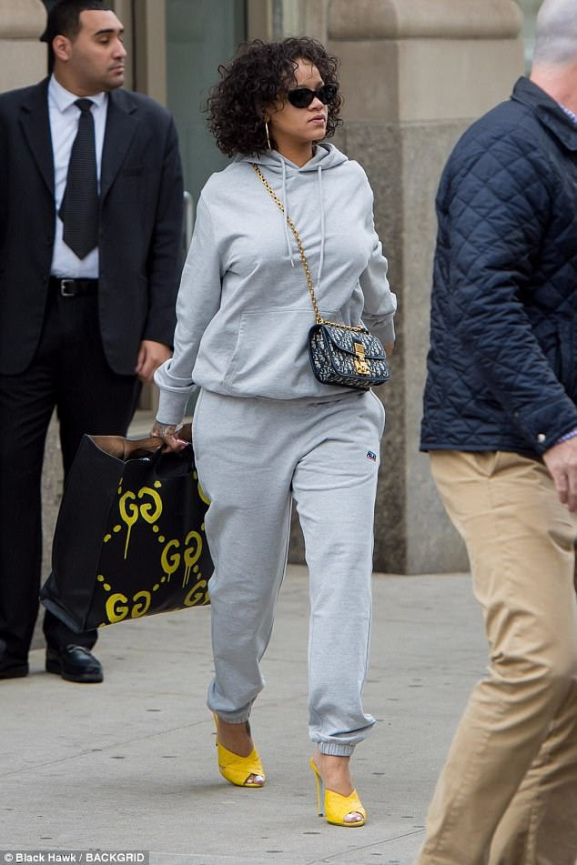 Fancy touch:Rihanna covered up her incredible curves in a grey hoodie with matching sweat bottoms while out in New York City on Thursday
