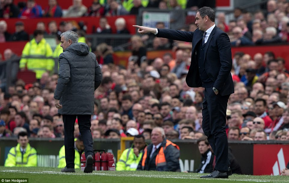 Swansea manager Paul Clement instructs his side while United boss Jose Mourinho patrols the touchline at Old Trafford