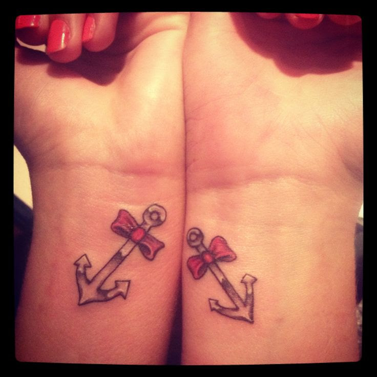 Anchor And Bow Tattoos On Wrists