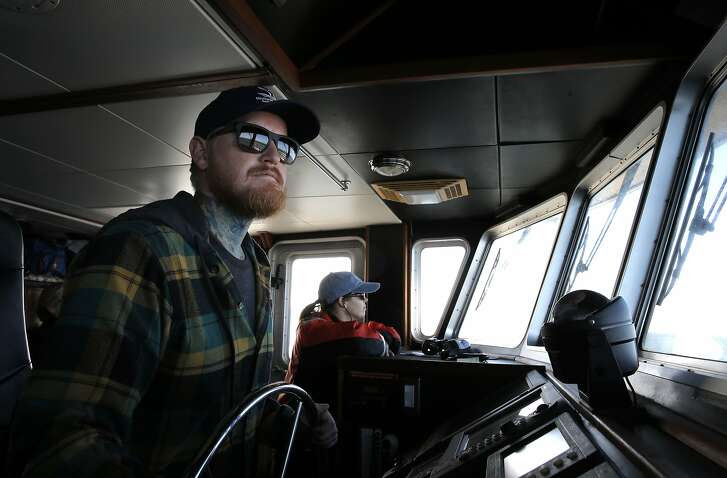 The ship's captain Chris Eubank and researchers Danielle Lipski scan the ocean from the bridge aboard the research vessel Fulmar, near San Francisco, Calif. on Fri. September 25, 2015. The crew of the Fulmar conducts the study ACCESS (Applied California Current Ecosystems Studies) a partnership that uses ocean research to inform resource managers, policy makers and conservation partners.