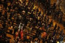 Protesters stand as riot police surround the area during an anti-government protest at Taksim Square in Istanbul