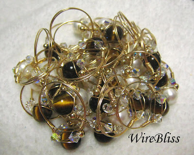 Wire wrapped sparkly crystal rings with tiger eye