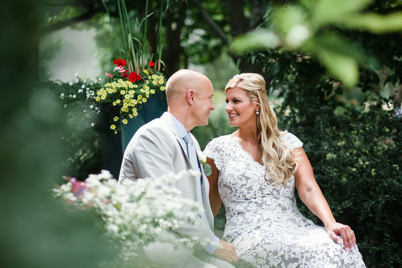 Pre-ceremony formals photos with the bride and groom before an intimate backyard wedding ceremony in Rockford IL. Photo by Mindy Joy Photography