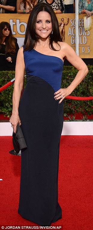 Style mavens: Julia Louis-Dreyfus (left) showed off her trim and toned physique in a colourblock black and blue number, Sarita Choudhury (centre) opted for an intricately embroidered midnight blue frock, while Jennifer Grey went for a body-hugging black midi-dress