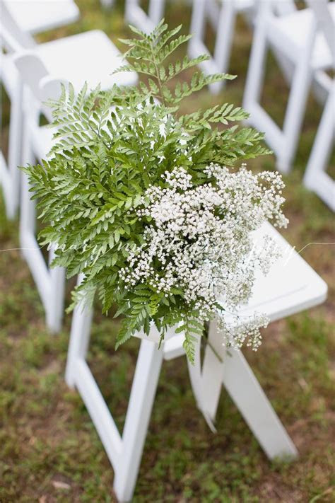 Aisle decor of leather leaf fern and baby's breath by