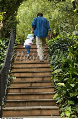 Father and Daughter Climbing Stairs    Stock Photo - Premium Rights-Managed, Artist: Peter Griffith, Code: 700-00549953