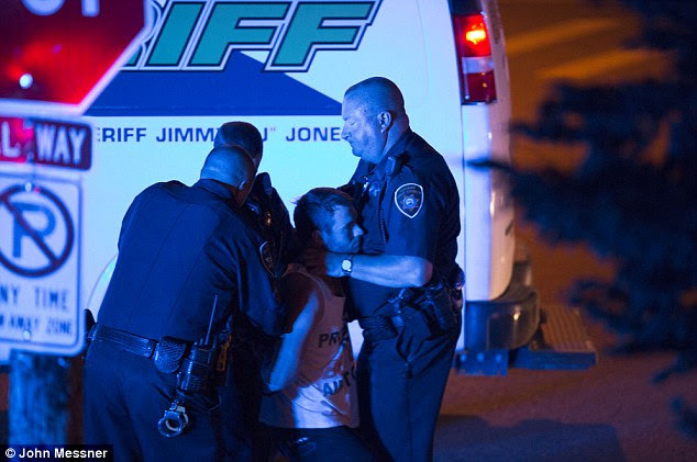Distressing: The officer's hands are still on the student's neck even as he passes out