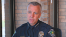 Police chief blasted over handling of aide's alleged racism