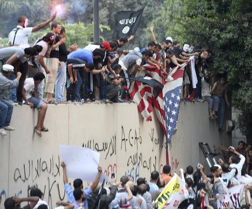 Demonstrators rip down US flag in Cairo, Egypt. The demonstrations were in response to a film that some say denigrates the Islamic religion. by Pan-African News Wire File Photos