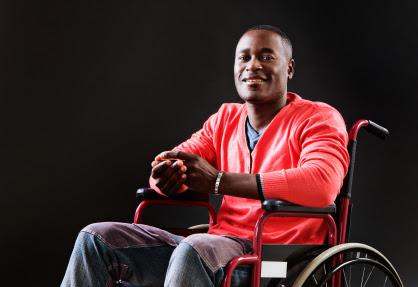 man in wheelchair happy