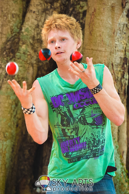 A boy juggling balls to earn extra income at St Paul's Church, Malacca area