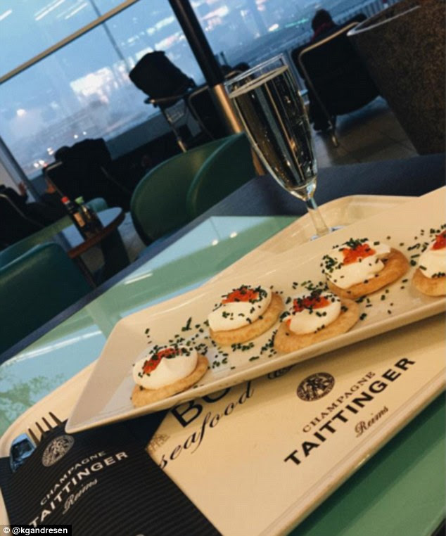 Part-time student: Flying back from university for the holidays, Katharina posted this snapshot of her extravagant airport snack of champagne and canapés. In the caption she wrote: 'Is it allowed to say that I'm 75% student?'