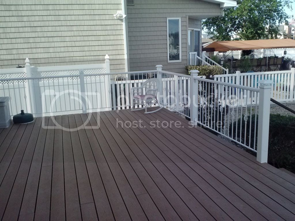 Metal handrails on a wooden deck. Any Ideas?
