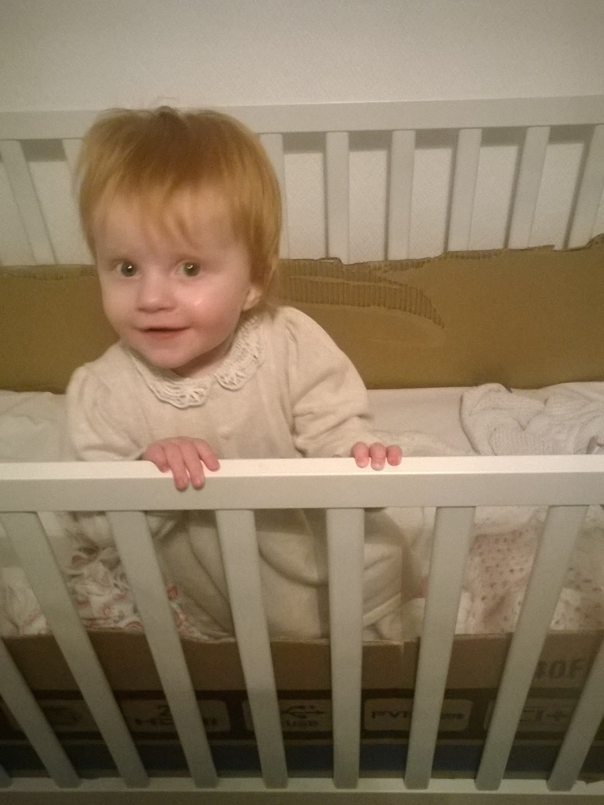 Marianna in her cot