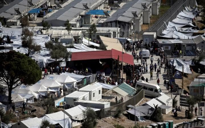 Mother and child killed after fire breaks out at Moria refugee camp