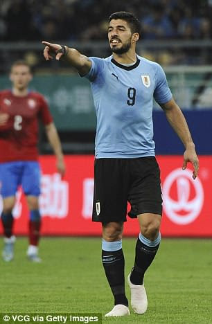 Luis Suarez wore both of Uruguay's World Cup strips in the China Cup back in March