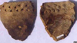 Imagem cedida pela Science mostra o fragmento de cerâmica encontrado no sul da China (AFP/Getty)