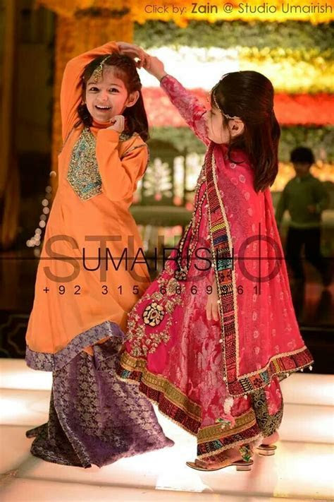 Pakistani little girls enjoying at wedding. Pinned by