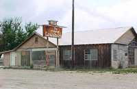 Here's the old Lowake Inn, in Lowake, Texas, looking abandoned--the airfield was in back of this building. <img alt=