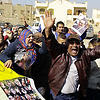 Supporters of former Egyptian President Hosni Mubarak celebrate after hearing the verdict of his trial outside a police academy on the outskirts of Cairo, Saturday, Nov. 29, 2014. (AAP)