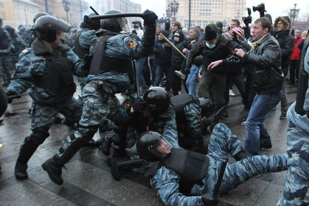 Football fans clash with riot police in central Moscow