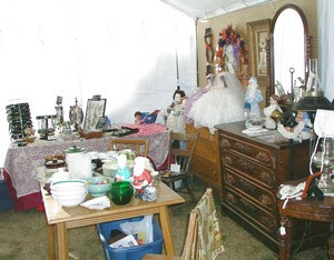 A peek inside our tent! See Tara's jewelry and the old walnut dresser?